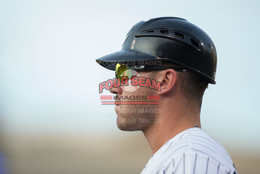 Nicky Delmonico (10) of the Charlotte Knights coaches first base during the game against the Pawtucket Red Sox at BB&T BallPark on July 6, 2016 in Charlotte, North Carolina.  The Knights defeated the Red Sox 8-6.  (Brian Westerholt/Four Seam Images)