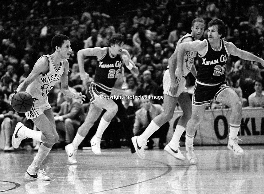 Warriors Phil Smith against Kansas City #20 Ed Nealy, and #22 Larry Drew...(1983 photo/Ron Riesterer)