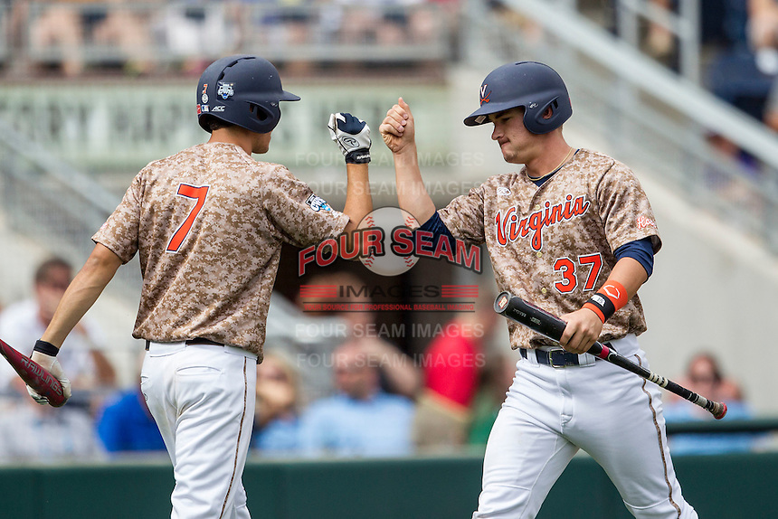 Virginia Cavaliers pinch runner Thomas Woodruff (37) is greeted by outfielder Adam Haseley (7) after scoring against the Arkansas Razorbacks in Game 1 of the NCAA College World Series on June 13, 2015 at TD Ameritrade Park in Omaha, Nebraska. Virginia defeated Arkansas 5-3. (Andrew Woolley/Four Seam Images)