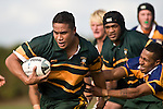 Daniel Crichton breaks past the clutches of Patumahoe winger S. Pomee. CMRFU Counties Power Premier Club Rugby game between Patumahoe & Pukekohe played at Patumahoe on April 12th, 2008..The halftime score was 10 all with Pukekohe going on to win 23 - 18.