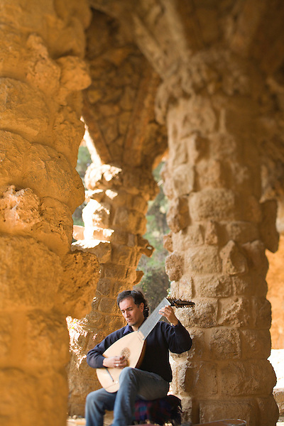 Miguel Angel Aldunce Gonzalez plays the lute in the Antoni Gaudi designed Park Guell in Barcelona, Spain. Photo by Kevin J. Miyazaki/Redux