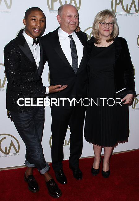 BEVERLY HILLS, CA - JANUARY 19: Pharrell Williams, Janet Healy, Christopher Meledandri at the 25th Annual Producers Guild Awards held at The Beverly Hilton Hotel on January 19, 2014 in Beverly Hills, California. (Photo by Xavier Collin/Celebrity Monitor)