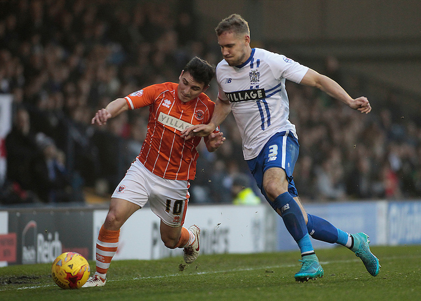 Blackpool's Jack Redshaw battles with Bury's Chris Hussey<br /> <br /> Photographer David Shipman/CameraSport<br /> <br /> Football - The Football League Sky Bet League One - Bury v Blackpool - Saturday 31st October 2015 - Gigg Lane - Bury <br /> <br /> &copy; CameraSport - 43 Linden Ave. Countesthorpe. Leicester. England. LE8 5PG - Tel: +44 (0) 116 277 4147 - admin@camerasport.com - www.camerasport.com