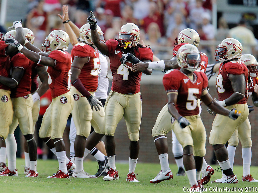 TALLAHASSEE, FL 9/25/10-FSU-WF FB10 CH-Florida State's Terrance Parks, center, celebrates snagging a Wake Forest fumble during fourth quarter action Saturday at Doak Campbell Stadium in Tallahassee. The Seminoles beat the Demon Deacons 31-0..COLIN HACKLEY PHOTO