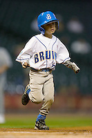 The UCLA Bruins bat boy runs out to retrieve a bat at home plate during game action versus the Rice Owls in the 2009 Houston College Classic at Minute Maid Park February 27, 2009 in Houston, TX.  The Owls defeated the Bruins 5-4 in 10 innings. (Photo by Brian Westerholt / Four Seam Images)