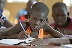 A boy studies in the Loreto Primary School in Rumbek, South Sudan. The Loreto Sisters began a secondary school for girls in 2008, with students from throughout the country, but soon after added a primary in response to local community demands.