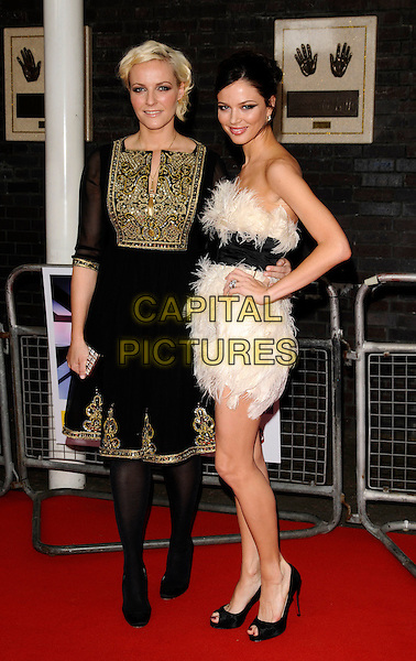 KEREN CRAIG & GEORGINA CHAPMAN.The Britain's Best 2008 Ceremony, The London Studios, South Bank, London, England..May 18th, 2008.full length black dress white feathers strapless belt sash hand on hip gold detail karen .CAP/CAN.©Can Nguyen/Capital Pictures.