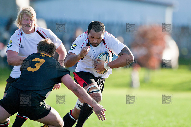 Taiasina Tuifua looks to fend off the tackle of Mark Nicolaas. Counties Manukau Steelers pre season ITM Cup game against a Bay of Plenty Wasps selection, played at Moore Park Katikati, on July 7th 2010.