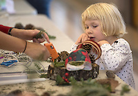 NWA Democrat-Gazette/J.T. WAMPLER  Lily Frala, 3, stands ready to help her mom, Jamie Frala of Fayetteville make a wreath Sunday Nov. 29, 2015 at St. Paul's Episcopal Church in Fayetteville. For a donation people were able to construct their own Advent Wreaths for the holiday season.