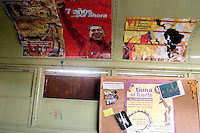 "A poster with Venezuelan President Hugo Chavez reading ""seven years, by now"" is displayed in a bus used as office by a cultural centre in Caracas, Venezuela, on Saturday, Jun. 21, 2006. (ALTERPHOTOS/Alvaro Hernandez)"