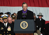 Norfolk, VA - January 10, 2009 -- Former United States President George H.W. Bush addresses delivers his remarks at the commissioning ceremony for the aircraft carrier USS George H.W. Bush (CVN 77) at Naval Station Norfolk, Virginia.  Bush delivered the keynote address at the commissioning. The Navy's newest, and final, Nimitz-class aircraft carrier is named after the World War II naval aviator and 41st president of the United States..Credit: Micah P. Blechner U.S. Navy via CNP