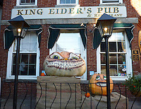 Two creepy pumpkins grin outside local pub in Damariscotta Maine