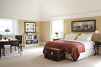 A comfortable guest bedroom: the painting above the bed is by Irish artist Robert Healy