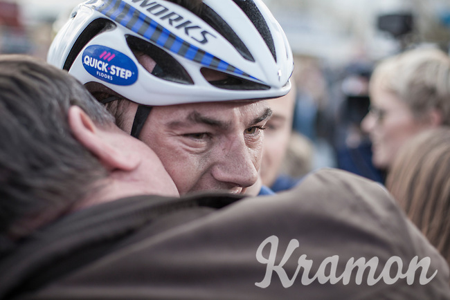 An emotional/happy Yves Lampaert (BEL/Quick Step Floors) , who lives very close to the finish) being hugged by friends & family after winning the 72nd Dwars door Vlaanderen 2017.