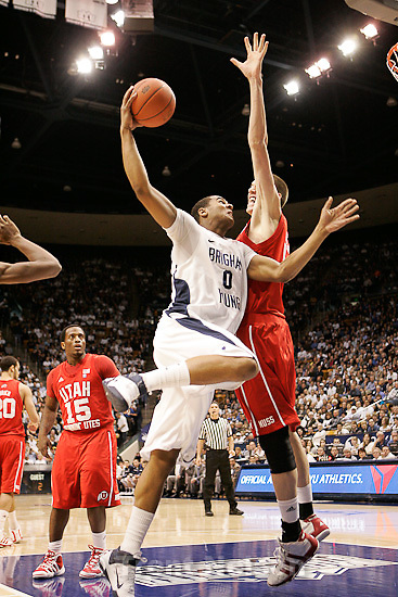 Trent Nelson  |  The Salt Lake Tribune.BYU's Brandon Davies shoots with Utah's David Foster defending in the first half at BYU vs. Utah, college basketball in Provo, Utah, Saturday, February 12, 2011.