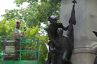 A worker cleans a statue in Lafayette Park near the White House in Washington D.C., U.S., on Wednesday, June 10, 2020.  Additional fencing had been set up near the White House in response to the demonstrations caused by the death of George Floyd while he was in police custody on May 25, 2020.  Credit: Stefani Reynolds / CNP/AdMedia