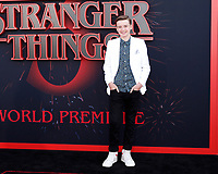 "LOS ANGELES - JUN 28:  Maxwell Jenkins at the ""Stranger Things"" Season 3 World Premiere at the Santa Monica High School on June 28, 2019 in Santa Monica, CA"