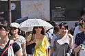 July 11, 2011 - Tokyo, Japan - A woman is seen holding a fashionable parasol in downtown Tokyo. Japanese people, especially middled-aged women, use parasols during the hot Summer months to avoid any form of skin cancer. Today, parasols are also becoming popular among young adult women due to various designs and colors available on the market. (Photo by Yumeto Yamazaki/AFLO)