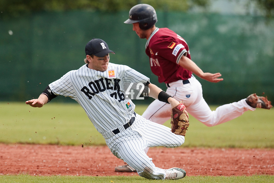 04 June 2010: Aaron Hornostaj of Rouen fails to catch the ball during the 2010 Baseball European Cup match won  20-7 by Heidenheim Heidekopfe over the Rouen Huskies, at the Kravi Hora ballpark, in Brno, Czech Republic.