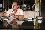 61 year old Lay Kee Tee, a former pig farmer and a  survivor of the Nipah virus talks about the virus outbreak at his house in Bukit Pelandok in Nageri Sembilan, Malaysia on October 16th, 2016. <br /> In September 1998, a virus among pig farmers (associated with a high mortality rate) was first reported in the state of Perak in Malaysia. Dr. Chua investigated and discovered the virus and it was later named, Nipah Virus. The outbreak in Malaysia was controlled through the culling of &gt;1 million pigs.