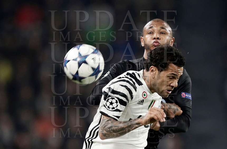 Juventus' Dani Alves, foreground, and Porto's Yacine Brahimi jump for the ball during the Champions League round of 16 soccer match against Porto at Turin's Juventus Stadium, 14 March 2017. Juventus won 1-0 (3-0 on aggregate) to reach the quarter finals.<br /> UPDATE IMAGES PRESS/Isabella Bonotto