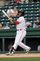Infielder Rafael Devers (13) of the Greenville Drive bats in a game against the Lexington Legends on Tuesday, April 14, 2015, at Fluor Field at the West End in Greenville, South Carolina. Devers is the No. 6 prospect of the Boston Red Sox, according to Baseball America. Lexington won, 5-3. (Tom Priddy/Four Seam Images)