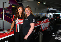 Feb 8, 2014; Pomona, CA, USA; NHRA top fuel dragster driver Leah Pritchett (left) and team owner Connie Dote during qualifying for the Winternationals at Auto Club Raceway at Pomona. Mandatory Credit: Mark J. Rebilas-