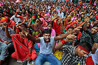 Bangladeshi garment workers shout slogans during a protest in Dhaka, Bangladesh, Friday, Sept. 13, 2013.
