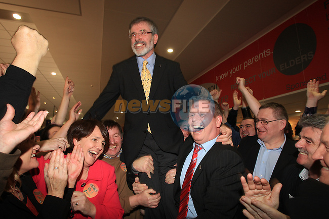 Gerry Adams celebrates with Sinn Fein supporters.at the Louth election count in the DKIT in Dundalk Co Louth..Picture: Fran Caffrey / www.newsfile.ie.