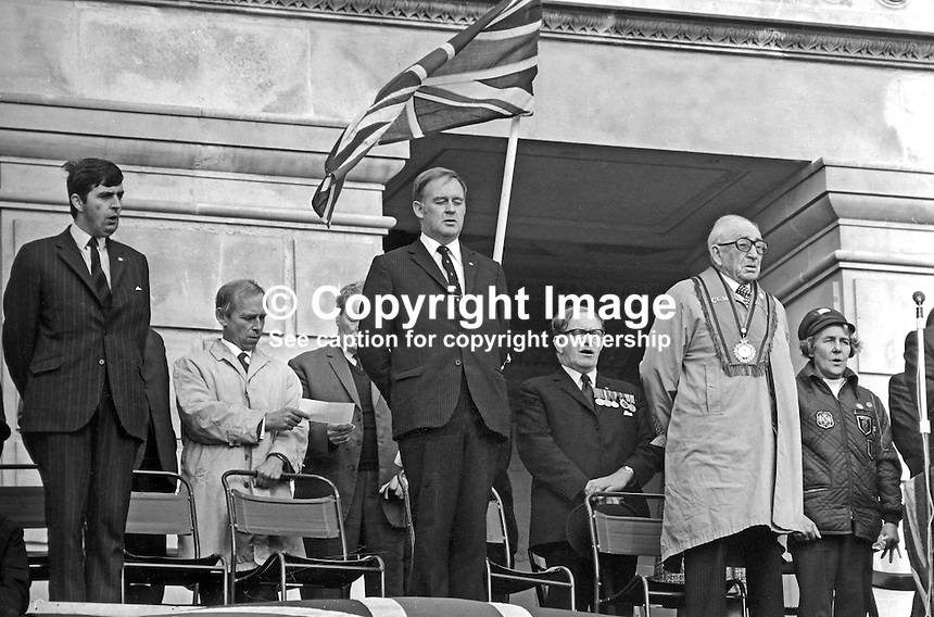 Ulster Vanguard, Loyalist Rally, Parliament Buildings, Stormont, N Ireland, 30th September 1972. Left to right - John Taylor, MP, Ulster Unionist, N Ireland Parliament; Stanley McMaster, MP, Ulster Unionist, East Belfast, UK Parliament; Cecil Harvey, prominent member, Ulster Vanguard; William Craig, MP, Larne, leader, Ulster Vanguard; Gerald Glover, former,Ulster Unionist Mayor, Londonderry; Lord Brookeborough, 1st Viscount, former, Ulster Unionist, Prime Minister, N Ireland Parliament; unknown woman; 1972093006001a<br />