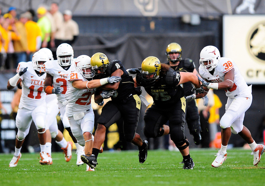 04 October 2008: Colorado tailback Demetrius Sumler is tackled by Texas safety Blake Gideon (21). The Texas Longhorns defeated the Colorado Buffaloes 38-14 at Folsom Field in Boulder, Colorado. For Editorial Use Only