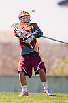 Los Angeles, CA 02/20/10 - Avery Brovick (USC # 11) in action during the USC-Loyola Marymount University MCLA/SLC divisional game at Leavey Field (LMU).  LMU defeated USC 10-7.