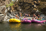 USA, Oregon, Wild and Scenic Rogue River in the Medford District, rafters stop to enjoy a waterfall on the rivers edge