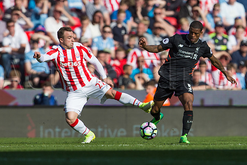 April 8th 2017, bet365 Stadium, Stoke on Trent, Staffordshire, England; EPL Premier League football, Stoke City versus Liverpool; Stoke City's Xherdan Shaqiri and Liverpool's Georginio Wijnaldum battle over a loose ball