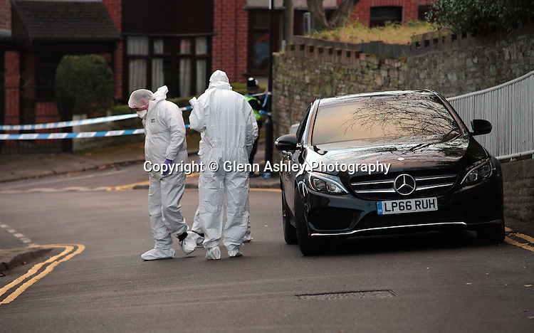 Scene of Crimes officers investigate the shooting on Daniel Hill Terrace in Sheffield where the victim later died., Sheffield, United Kingdom, 18th February 2017. Photo by Glenn Ashley.