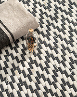 Ziggurat Petite, a hand-cut tumbled mosaic, shown in Nero Marquina and Calacatta, is part of the Tissé™ collection for New Ravenna.