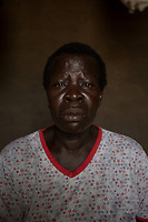 "Uganda - Palorinya Refugee Settlement - Alice Kideu Wani Kaya, 62, is a South Sudanese refugee who arrived in Palorinya on February 2017. She is now fostering five orphans, raising them along her own 10-year-old child. ""As we were fleeing South Sudan together I was really worried. We had neither food, nor shelter and I kept on asking myself 'What am I going to do with these children?'. During the first months here we really suffered together. It unified us, binding us into a family"", she says."
