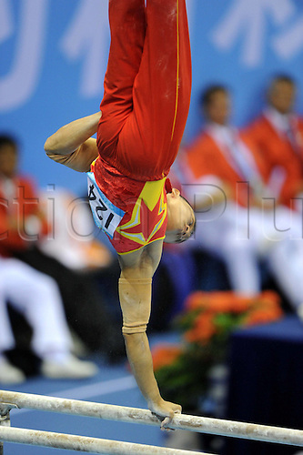 16 08 2011 Shenzhen, China.  Wang  of China Competes during the mens In parallel Bars of Artistic Gymnastics Event AT The 26th Summer Universiade in Shenzhen A City of South China s Guangdong Province Wang Won The Gold Medal with 15 850 Points