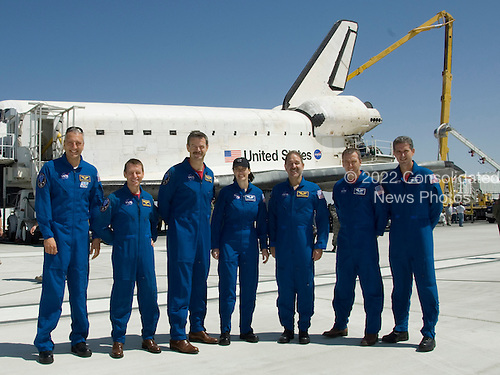 Edwards, CA - May 24, 2009 -- The crew of space shuttle mission STS-125 gathered on the runway after the shuttle Atlantis landed. From left are Mike Massimino, Greg Johnson, Scott Altman, Megan McArthur, John Grunsfeld, Andrew Feustel and Michael Good..Mandatory Credit: Tony Landis - NASA via CNP