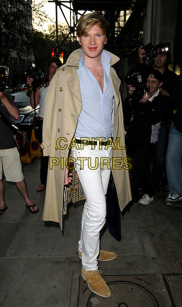 HENRY CONWAY & GUEST .Belvedere Vodka Jagger Dagger Launch Party, 7 Berkeley Street, London, England. May 8th, 2008..full length Burberry check plaid coat trench blue shirt white trousers jeans .CAP/CAN.©Can Nguyen/Capital Pictures