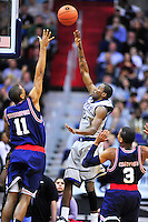 Jason Clark of the Hoyas shoots over Tigers' Wesley Witherspoon. Georgetown defeated Memphis 70-59 at the Verizon Center in Washington, D.C. on Thursday, December 22, 2011. Alan P. Santos/DC Sports Box