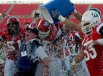 012205 Las Vegas Classic East Vs West college football  won by West 20-16. West's Michigan coach  Jerry Hanlon gets the traditional water dump after winning