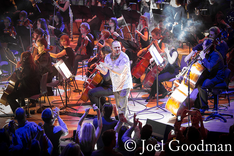 "© Joel Goodman - 07973 332324 . 05/02/2016 . Manchester , UK . NICKY LOCKETT ( MC Tunes ) emcees .  "" Hacienda Classical "" debut at the Bridgewater Hall . The 70 piece Manchester Camerata and performers including New Order's Peter Hook , Shaun Ryder , Rowetta Idah , Bez and Hacienda DJs Graeme Park and Mike Pickering mixing live compositions . Photo credit : Joel Goodman"