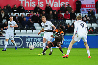 Mike van der Hoorn of Swansea City vies for possession with Moses Odubajo of Brentford during the FA Cup Fifth Round match between Swansea City and Brentford at the Liberty Stadium in Swansea, Wales, UK. Sunday 17 February 2019
