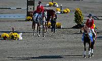 Harbour Pilot, with rider Hannah Sue Burnett, stand for the National Anthem after winning at the Fair Hill International at Fair Hill Natural Resources Area in Fair Hill, Maryland on October 21, 2012. Burnett won her third Fair Hill International with a double clear stadium jumping round.