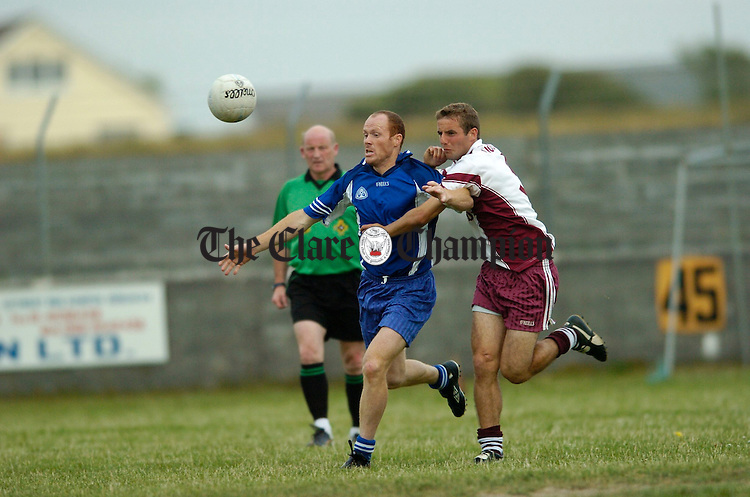Michael Liddane from Kilballyowen is tackled by Liscannor's Thomas Mc Donagh during their meeting at Miltown. Photograph by John Kelly.