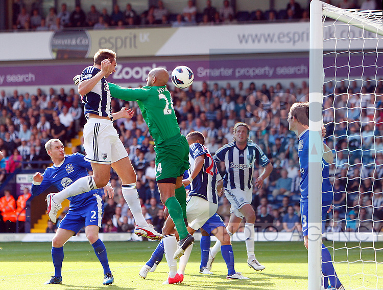 ".Football - West Bromwich Albion v Everton - Barclays Premier League - The Hawthorns - Season 12/13 - 1/9/12 .West Brom""s Gareth Mcauley beats Everton's Tim howard to the ball to score the 2nd goal.Mandatory Credit: Si.Mandatory Credit: Simon Bellis/Sportimage.EDITORIAL USE ONLY. No use with unauthorized audio, video, data, fixture lists, club/league logos or ?live? services. Online in-match use limited to 45 images, no video emulation. No use in betting, games or single club/league/player publications. Please contact your account representative for further details..."