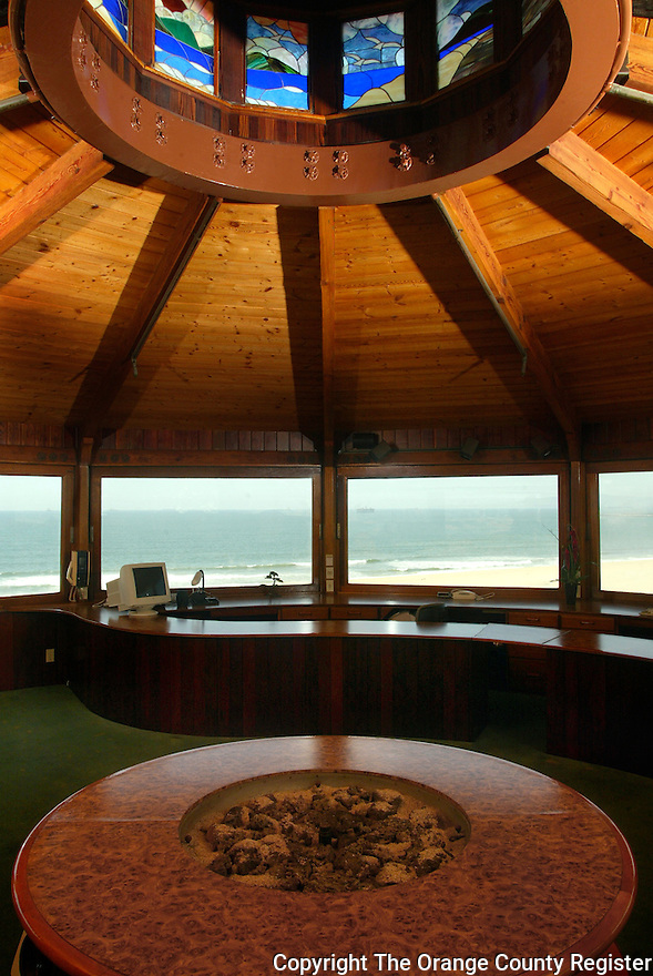 The top floor of this Seal Beach water tower house has an incredible 360 view 85 feet up off the ground.  It serves as an office but also has a fire pit in the center.  Above the center of the room are stained glass windows each depicting a similar view as seen through the normal windows.