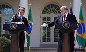 March 19, 2019 - Washington, DC, United States: United States President Donald J. Trump holds a news conference with President Jair Bolsonoro of Brazil at the White House. <br /> Credit: Chris Kleponis / Pool via CNP