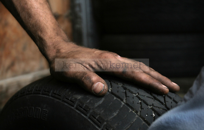 Branden Tirey rests after a long day of work at H&H Tires on Oct. 1, 2010. Photo by Matt Murray